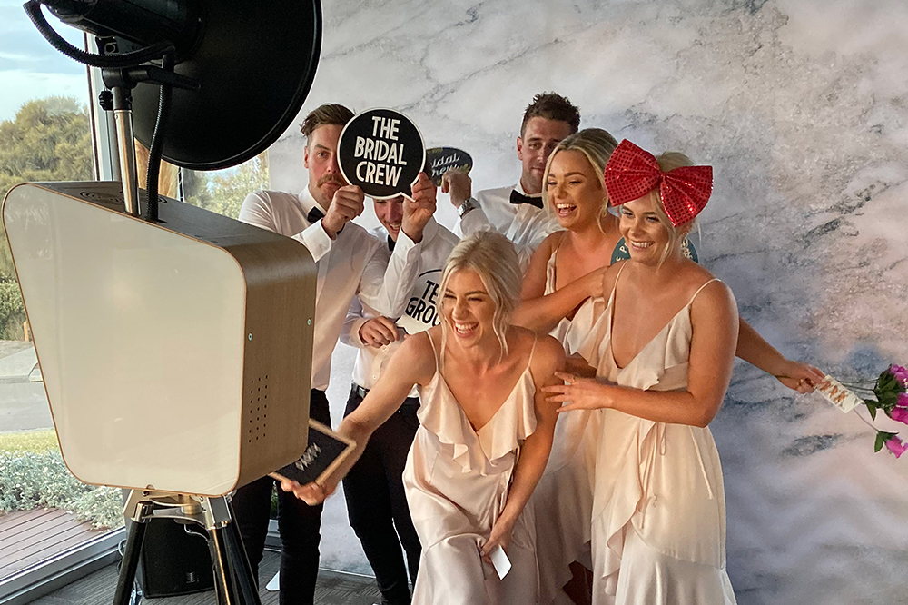 Retro open air photo booth being used at Wedding